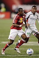 Red Bulls defender (2) Marvell Wynne is marked by New England Revolution defender (16) James Riley. The Revolution defeated the Red Bulls 2-0 in an MLS regular season match at Giants Stadium, East Rutherford, NJ, September 20, 2006.