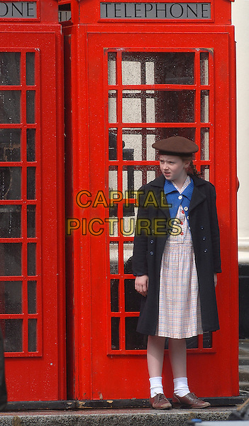 "ATMOSPHERE .Filming on the set of ""Nanny McPhee and the Big Bang"", Regent Crescent, London, England..July 19th, 2009.gv general view full length acting red phone box telephone blue jacket dress hat brown .CAP/IA.©Ian Allis/Capital Pictures."