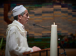 A Muslim imam, Marzouk Aulad Abdellah, prays during a July 23 interfaith prayer and memorial service in the Keizersgrachtkerk in Amsterdam, the Netherlands. Sponsored by the World Council of Churches-Ecumenical Advocacy Alliance, the service was held on the first day of the 2018 International AIDS Conference.