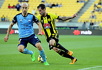 Wellington's Tom Doyle turns inside Sydney's Adrian Mierzejewski during the A-League football match between Wellington Phoenix and Sydney FC at Westpac Stadium in Wellington, New Zealand on Saturday, 23 December 2017. Photo: Dave Lintott / lintottphoto.co.nz
