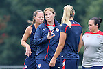 18 August 2014: Head coach Jill Ellis (center) with Julie Johnston (back turned) and Christie Rampone (behind). The United States Women's National Team held a training session on Field 4 at WakeMed Soccer Park in Cary, North Carolina.