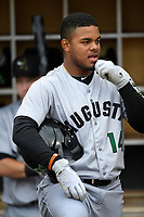 Center fielder Heliot Ramos (14) of the Augusta GreenJackets waits on the steps of the dugout before a game against the Columbia Fireflies on Saturday, April 7, 2018, at Spirit Communications Park in Columbia, South Carolina. Augusta won, 6-2. (Tom Priddy/Four Seam Images)