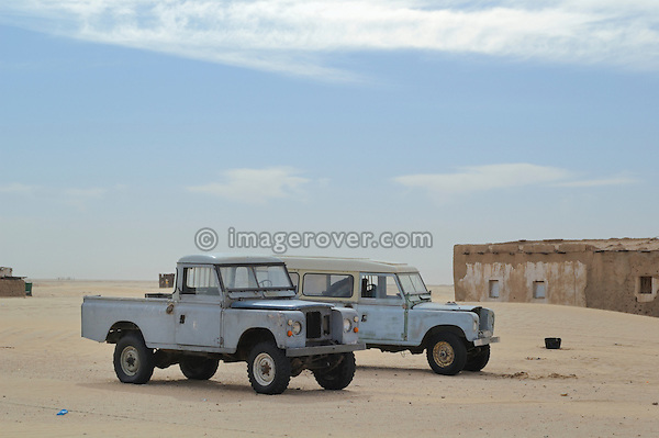 Africa, Mauritania, Sahara Desert. Old Series 3 Land Rover at a small village between Nouadhibou and Choum. --- No releases available. Automotive trademarks are the property of the trademark holder, authorization may be needed for some uses.