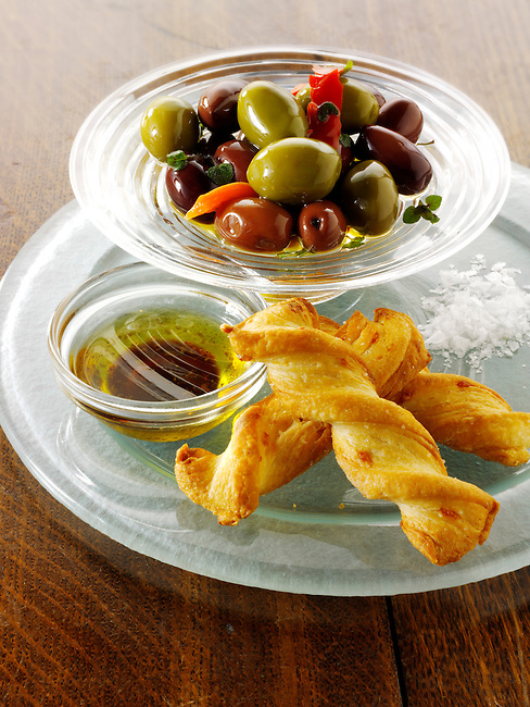 Olives, dipping oil and bread sticks snack