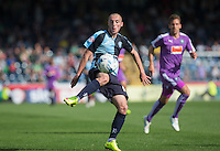 Michael Harriman of Wycombe Wanderers crosses the ball during the Sky Bet League 2 match between Wycombe Wanderers and Plymouth Argyle at Adams Park, High Wycombe, England on 12 September 2015. Photo by Andy Rowland.