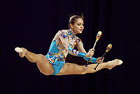 September 22, 2003, Budapest, Hungary -- Rhythmic gymnastic star IRINA TCHACHINA of Russia leaps with clubs during training at 2003 Rhythmic Gymnastics World Championships.