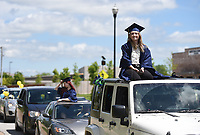 "Vivian Reed (right) smiles as she waits with a convoy of gradutes to receive her diploma, Sunday, May 17, 2020 during a graduation ceremony at the Northwest Arkansas Classical Academy in Bentonville. Northwest Arkansas Classical Academy hosted a graduation ceremony -- actually, a ""graduation convoy"" for its 17 seniors. Teachers and families parked throughout the parking lot. Seniors drove slowly through the lot while teachers and family members honked and waved to celebrate them. At the end of the route, headmaster Susan Provenza gave seniors their diplomas. Visit nwaonline.com/200518Daily/ for today's photo gallery.<br /> (NWA Democrat-Gazette/Charlie Kaijo)"