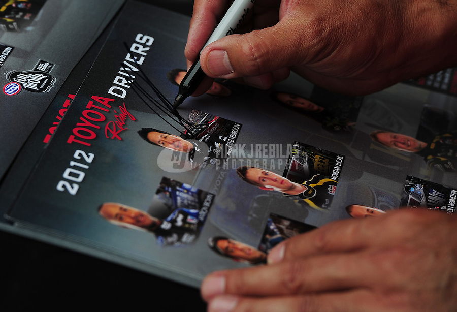Jun. 29, 2012; Joliet, IL, USA: Detailed view as NHRA funny car driver Cruz Pedregon signs an autograph during qualifying for the Route 66 Nationals at Route 66 Raceway. Mandatory Credit: Mark J. Rebilas-