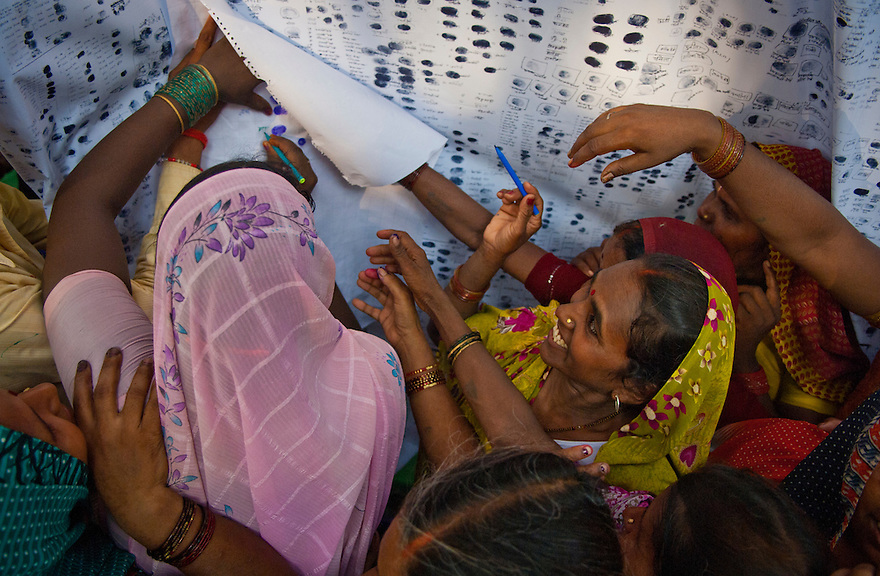 Indian women signs a charter in a bid to empower women in the Northern Indian state of Uttar Pradesh, India on the 9th of July 2010.