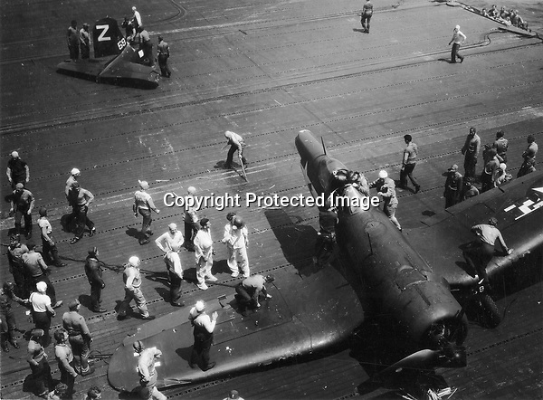 'Doc' Snavely landed a F4U Corsair at fast speed with no flaps, the tail hook caught the arresting cable and the tail snapped off. Snavely uninjured. - Aug. 9, 1945