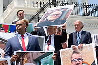 United States Senator Ben Cardin (Democrat of Maryland) holds a photo of a person who has a pre-existing condition during a press conference on Capitol Hill in Washington D.C., U.S. to discuss health care coverage for those with pre-existing conditions on July 9, 2019.<br /> CAP/MPI/RS<br /> ©RS/MPI/Capital Pictures