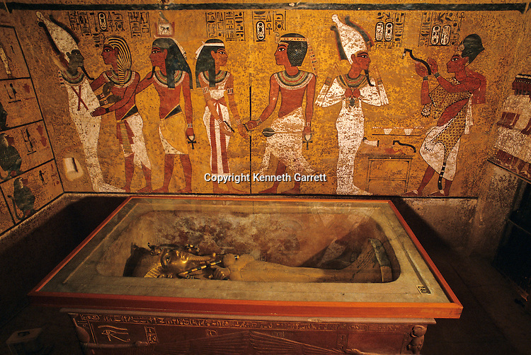 Egypt's Valley of the kings, Tut's tomb surronded by wall fresco depicting pharoah followed by ka embracing Osiris, New Kingdom