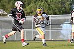 Palos Verdes, CA 03/30/10 - Sage Abraham (Palos Verdes #33) and \pj0\ in action during the Palos Verdes-Peninsula JV Boys Lacrosse game.