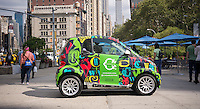 C. Wonder engages with consumers at an event in Madison Square in New York on Saturday, September 20, 2014. C. Wonder was promoting their new store in the Flatiron neighborhood using decorated Smart Cars, one filled with gumballs for visitors to guess the amount.  (© Richard B. Levine)