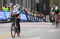 NWA Democrat-Gazette/J.T. WAMPLER Chloe Dygert pumps her fist after winning the pro women's category of the criterium portion of the 41st annual Joe Martin Stage Race in downtown Fayetteville Sunday April 15, 2018.
