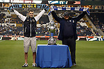 30 September 2015: Supporters for the two teams pose after walking the championship trophy onto the field before the game. Corey Furlan from Philadelphia's Sons of Ben (left) and Sean Dane from Kansas City's Cauldron (right). The Philadelphia Union hosted Sporting Kansas City at PPL Park in Chester, Pennsylvania in the 2015 Lamar Hunt United States Open Cup Final. The game ended in a 1-1 tie after extra time. Sporting Kansas City won the Championship by winning the penalty kick shootout 7-6.