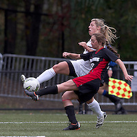 Boston College forward Stephanie Wirth (22) crosses the ball as NC State defender Randi Soldat (22) defends. Boston College defeated North Carolina State,1-0, on Newton Campus Field, on October 23, 2011.