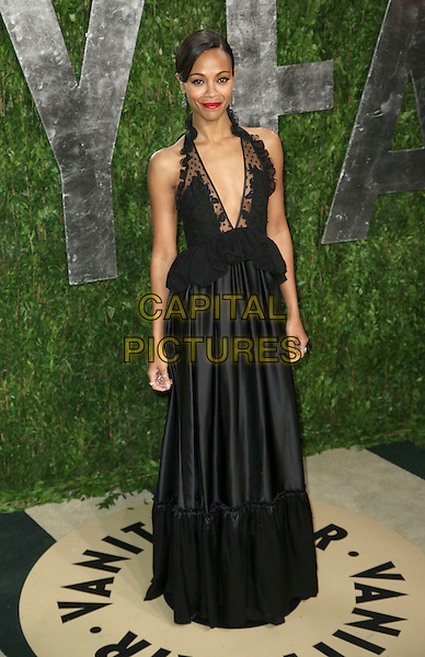 Zoe Saldana.2013 Vanity Fair Oscar Party following the 85th Academy Awards held at the Sunset Tower Hotel, West Hollywood, California, USA..February 24th, 2013.oscars full length black dress peplum lace plunging neckline cleavage silk satin skirt .CAP/ADM/SLP/DOW.©Dowling/StarlitePics/AdMedia/Capital Pictures