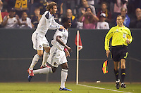 David Beckham of the LA Galaxy (red shoes) jumps on the back of goalscoring teammate Edson Buddle (blue shoes) in celebration. The Colorado Rapids defeated the LA Galaxy 3-2 at Home Depot Center stadium in Carson, California on Saturday October 16, 2010.