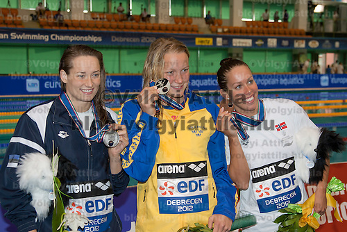Silver medalist Triin Ajand (L) of Estonia, gold medalist Sarah Sjoestroem (C) of Sweden and bronze medalist Ingvild Snildal (R) of Norway celebrate their victory in the Women's 50m Butterfly final of the 31th European Swimming Championships in Debrecen, Hungary on May 22, 2012. ATTILA VOLGYI