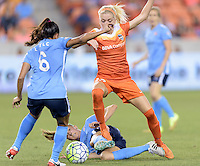 Denise O'Sullivan (13) of the Houston Dash gets tangled up with a Sky Blue FC player near the Sky Blue goal on Friday, April 29, 2016 at BBVA Compass Stadium in Houston Texas. The Houston Dynamo and Sky Blue FC tied 0-0.