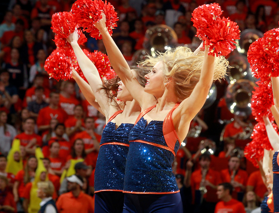 Virginia cheerleaders perform during the game Saturday Feb. 7, 2015, in Charlottesville, Va. Virginia defeated Louisville  52-47. (Photo/Andrew Shurtleff)