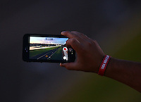 Jun 10, 2016; Englishtown, NJ, USA; Detailed view as an NHRA fan uses his iPhone camera to record video during qualifying for the Summernationals at Old Bridge Township Raceway Park. Mandatory Credit: Mark J. Rebilas-USA TODAY Sports
