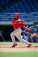 Philadelphia Phillies right fielder Jhailyn Ortiz (13) follows through on a swing during a Florida Instructional League game against the Toronto Blue Jays on September 24, 2018 at Spectrum Field in Clearwater, Florida.  (Mike Janes/Four Seam Images)