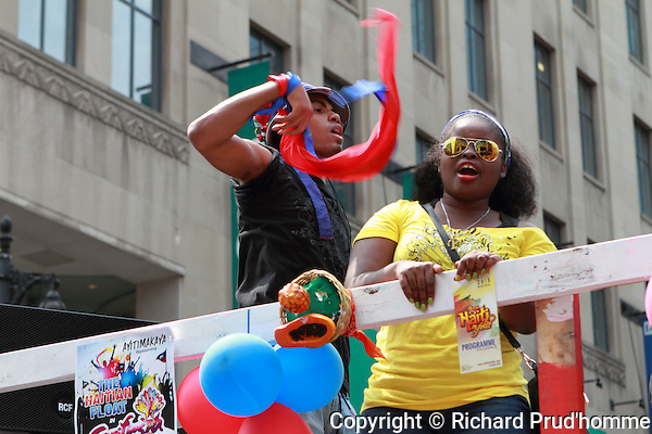 Participants on one of the floats of the Carifiesta parade in downtown Montreal