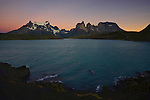 Lake Pehoe at dawn serves as the foreground for the majestic mountains of Torres del Paine National Park, Chile.