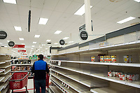 This canned goods section is bare during these days of the COVID-19 pandemic, at the Target store in Alexandria, Va., Monday, March16, 2020. Credit: Rod Lamkey / CNP/AdMedia