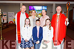 Killahan NS students Ciara Nolan, John Murphy and Aoife Behan standing with Fr Denis O'Mahoney, Janine McGuire (Teacher), Bríd Leonard (Principal) and Bishop Ray Brown at their confirmation in St Bernard's Church, Abbeydorney on Tuesday.