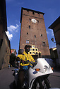 Ghananian immigrant rides a motorcycle along Torre steet (center of the village) in Nonantola, Saturday, Jun 27, 1996...Immigrato ghanese in motocicletta in via della Torre.