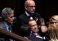 Il leader del Popolo della Liberta' Silvio Berlusconi parla con alcuni deputati e senatori durante la sesta seduta comune di senatori e deputati per l'elezione del nuovo Capo dello Stato, alla Camera dei Deputati, Roma, 20 aprile 2013..People of Freedom party's leader Silvio Berlusconi is greeted by his lawmakers during the sixth common plenary session of senators and deputies to elect the new Head of State, at the Lower Chamber in Rome, 20 April 2013..UPDATE IMAGES PRESS/Isabella Bonotto