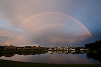 A full rainbow extends across the sky above the retention pond in the backyard of a home in the Whitfield subdivision in Oakleaf Plantation in Orange Park, Fl. Sunday evening July 24, 2011.  (Rick Wilson/Rick Wilson Photography)