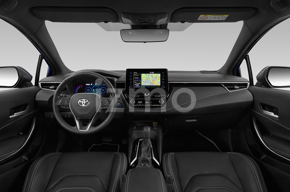 Stock photo of straight dashboard view of a 2019 Toyota Corolla Touring Sports Premium 5 Door Wagon