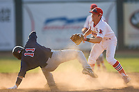 Second baseman Packy Elkins #9 puts the tag on Gunner Glad #11 of the Elizabethton Twins at Howard Johnson Field July 3, 2010, in Johnson City, Tennessee.  Photo by Brian Westerholt / Four Seam Images