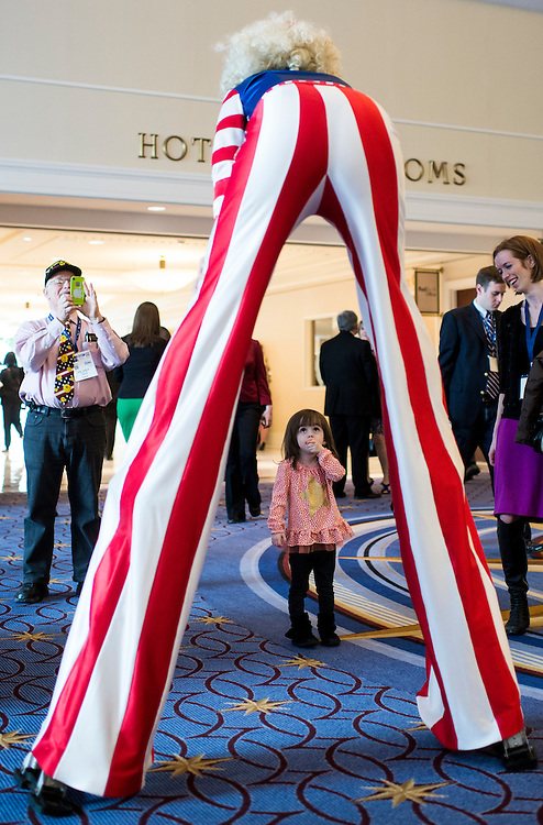 UNITED STATES - MARCH 7:  2 1/2 year old Reagan Schilling looks up at Maria Kent, of NYC Stilts, in the hallway during the American Conservative Union's Conservative Political Action Conference (CPAC) at National Harbor, Md., on Friday, March 7, 2014. (Photo By Bill Clark/CQ Roll Call)