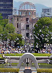 August 6, 2011, Hiroshima, Japan - Against the backdrop of the A-bomb dome, doves are released to highlight a memorial ceremony at Peace Memorial Park in Hiroshima on Saturday, August 6, 2011. ....Japan observed the 66th anniversary of the atomic bombing with a moment of silence and the release of doves in a memorial ceremony as the nation struggles to put a different kind of nuclear disaster under control at the crippled power plant in northeast. The worlds first A-bomb destroyed most of this western industrial city, killing as many as 140,000 people in the summer of 1945. A second atomic bombing Aug. 9 that year in Nagasaki killed tens of thousands more and prompted the Japanese to surrender. (Photo by Natsuki Sakai/AFLO [3615] -mis-