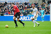 Sunday, 23 November 2012<br /> <br /> Pictured: Robin van Persie of Manchester United and Ashley Williams of Swansea City<br /> <br /> Re: Barclays Premier League, Swansea City FC v Manchester United at the Liberty Stadium, south Wales.