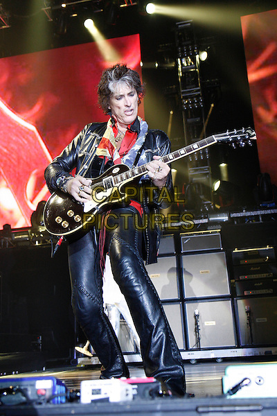 AEROSMITH - Joe Perry.Performing live at the O2 Arena, London, England..June 15th, 2010.stage concert live gig performance music full length black leather jacket trousers guitar american flag scarf.CAP/MAR.© Martin Harris/Capital Pictures.