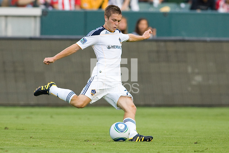 LA Galaxy midfielder Michael Stephens sends a ball down field assisting on teammate Edson Buddle's goal. The LA Galaxy beat Chivas USA 2-1 at Home Depot Center stadium in Carson, California on Sunday October 3, 2010.