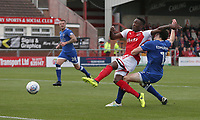 Fleetwood Town's Devante Cole shoots under pressure from Oldham Athletic's George Edmundson<br /> <br /> Photographer Stephen White/CameraSport<br /> <br /> The EFL Sky Bet League One - Fleetwood Town v Oldham Athletic - Saturday 9th September 2017 - Highbury Stadium - Fleetwood<br /> <br /> World Copyright &copy; 2017 CameraSport. All rights reserved. 43 Linden Ave. Countesthorpe. Leicester. England. LE8 5PG - Tel: +44 (0) 116 277 4147 - admin@camerasport.com - www.camerasport.com
