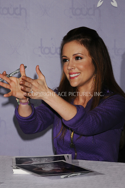 WWW.ACEPIXS.COM . . . . .  ....April 15 2009, New York City....Actress Alyssa Milano signed pictures for fans to promote the 'Touch' Collection at the NBA Store on April 15, 2009 in New York City.....Please byline: AJ Sokalner - ACEPIXS.COM..... *** ***..Ace Pictures, Inc:  ..tel: (212) 243 8787..e-mail: info@acepixs.com..web: http://www.acepixs.com
