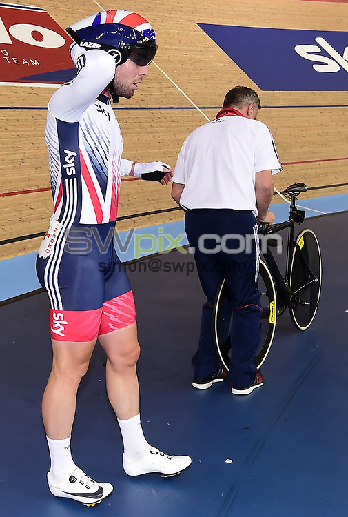 Picture by Alex Broadway/SWpix.com - 06/03/2016 - Cycling - 2016 UCI Track Cycling World Championships, Day 5 - Lee Valley VeloPark, London, England - Mark Cavendish of Great Britain holds his head after crashing in the Men's Madison Final.