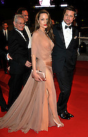 ANGELINA JOLIE &amp; BRAD PITT <br /> Leaving the premiere of &quot;Inglorious Basterds&quot;  at the Grand Theatre Lumiere  during the 62nd Cannes International Film Festival, Cannes, France, <br /> May 20th 2009.<br /> full length departures black suit tux tuxedo Tom Ford long beige peach silk dress maxi draped v-neck clutch bag satin shoes open toe cream couple leaving walking bow tie white shirt leg thigh slit split sheer <br /> CAP/PL<br /> &copy;Phil Loftus/Capital Pictures /MediaPunch ***NORTH AND SOUTH AMERICAS ONLY***