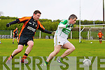 Padraig Lyons of Ballydonoghue breaks away from David McGillicudda of Sneem/Derrynane in the Credit Union County League Division 5 last Sunday in Ballydonoghue.