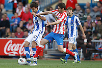 02.05.2012 SPAIN -  La Liga matchday 20th  match played between Atletico de Madrid vs Real Sociedadl (1-1) at Vicente Calderon stadium. The picture show Xabier Prieto Argarate (Midfielder of Real Sociedad) and Gabriel Fernandez Arenas (Spanish midfielder of At. Madrid)
