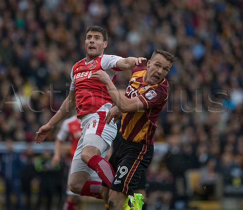 May 4th 2017, Northern Commercials Stadium, Bradford, England; FA League 1 playoffs, Bradford City versus Fleetwood Town ; Bobby Grant of Fleetwood Town and Anthony McMahon of Bradford City challenge for the ball