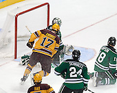 Justin Holl's (not pictured) shot goes in with .06 seconds remaining in the third period to give Minnesota the victory. - The University of Minnesota Golden Gophers defeated the University of North Dakota 2-1 on Thursday, April 10, 2014, at the Wells Fargo Center in Philadelphia to advance to the Frozen Four final.